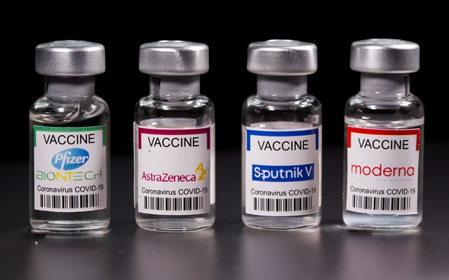 Vials with Pfizer-BioNTech, AstraZeneca, Sputnik V, and Moderna coronavirus disease (COVID-19) vaccine labels are seen in this illustration picture taken March 19, 2021. REUTERS