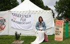 Climate activist Lea Bonasera looks on during a hunger strike, in a small camp near the chancellery in Berlin, Germany, September 24, 2021. Reuters