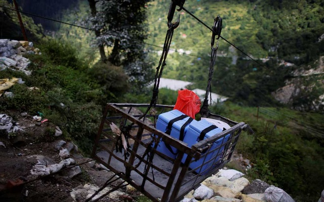 Medical kits and boxes containing COVISHIELD vaccines, are transported on a ropeway trolley to Malana village, during the coronavirus disease (COVID-19) outbreak, in Kullu district in the Himalayan state of Himachal Pradesh, India, September 14, 2021. Reuters