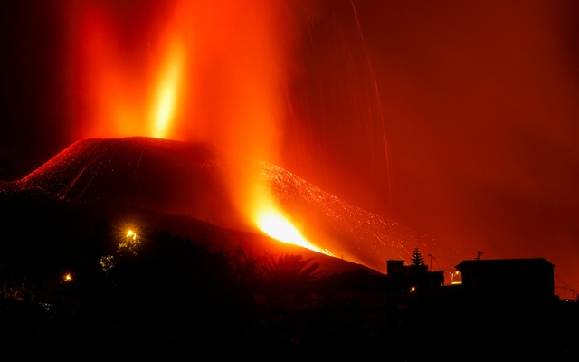 Lava and smoke rise following the eruption of a volcano on the Canary Island of La Palma, in El Paso, Spain, September 25, 2021. Picture taken with a long exposure. REUTERS/Jon Nazca