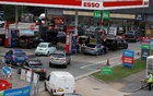 Drivers queue to enter a fuel station in London, Britain, September 25, 2021. Reuters