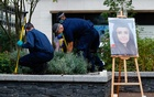 A portrait of Sabina Nessa, a teacher who was murdered in Pegler Square, is seen as police officers search the area prior to a vigil, in London, Britain September 24, 2021. REUTERS/Peter Nicholls
