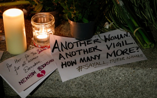 A placard is seen among flowers and candles during a vigil in memory of Sabina Nessa, a teacher who was murdered in Pegler Square, in London, Britain September 24, 2021. REUTERS/Peter Nicholls