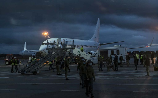 People who were evacuated from Kabul arrive on a Ukranian military flight at the airport in Boryspil, outside Kyiv, Thursday, Sept 23, 2021. Few countries have been willing to fly rescue missions into Afghanistan since the Americans left. Ukraine is an exception. Brendan Hoffman/The New York Times