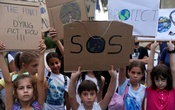 Children hold placards during a global climate change strike rally in Nicosia, Cyprus September 27, 2019. REUTERS/Yiannis Kourtoglou/File Photo