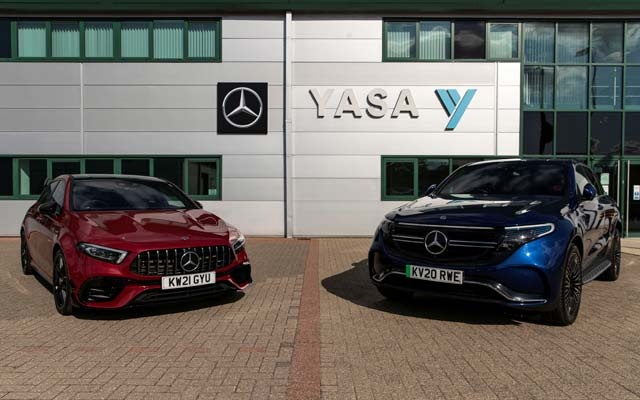 Two electric cars are parked at YASA headquarters and production facility in Oxford, Britain, August 24, 2021. REUTERS