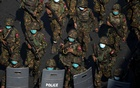 Myanmar soldiers from the 77th light infantry division walk along a street during a protest against the military coup in Yangon, Myanmar, Feb 28, 2021. REUTERS