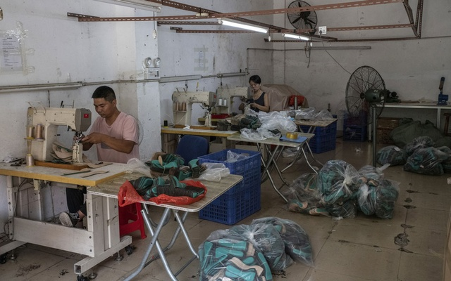 A workshop produces parts for a shoe manufacturer in Dongguan, China on Sept 27, 2021. Power cuts and even blackouts have slowed or closed factories across China in recent days, adding a new threat to the country's slowing economy and potentially further snarling global supply chains ahead of the busy Christmas shopping season in the West. (Gilles Sabrié/The New York Times)