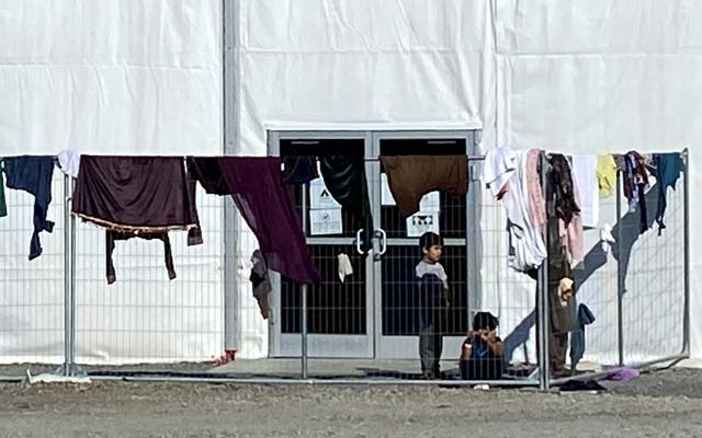 A structure housing Afghan evacuees is seen at Joint Base McGuire-Dix-Lakehurst, New Jersey, which has surged housing and supplies to host more than 9,300 Afghans awaiting resettlement in the United States, September 27, 2021. REUTERS