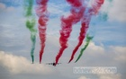 Bangladesh Air Force's C-130 and K-8 aircraft release smoke in red and green, the colours of the country's national flag, in an aerial display in the sky as part of celebrations of its 50th anniversary on Tuesday, Sept 28, 2021. Photo: Mahmud Zaman Ovi