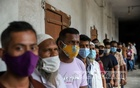People wait for the first dose of a coronavirus vaccine during a mass drive on the occasion of Prime Minister Sheikh Hasina's birthday at Rajdhani High School in Dhaka on Tuesday, Sept 28, 2021. Photo: Mahmud Zaman Ovi