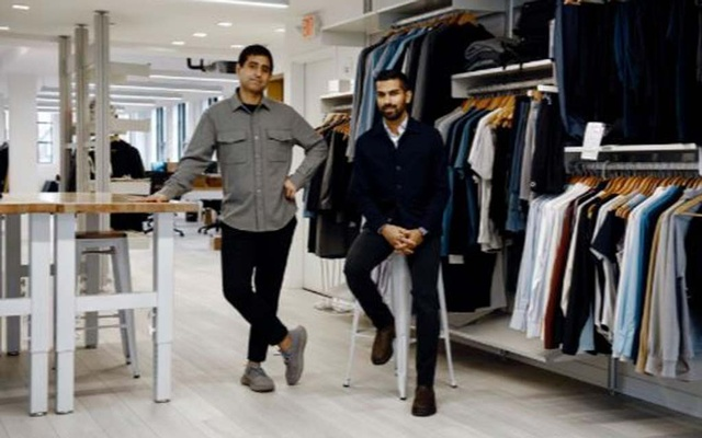 Gihan Amarasiriwardena, right, with his Ministry of Supply co-founder Aman Advani, at the apparel company's offices in Boston on Feb. 24, 2021. The brand paid about $1.50 per $125 shirt in transportation costs before the pandemic; now, they say, the cost is nearly $6. (Tony Luong/The New York Times)