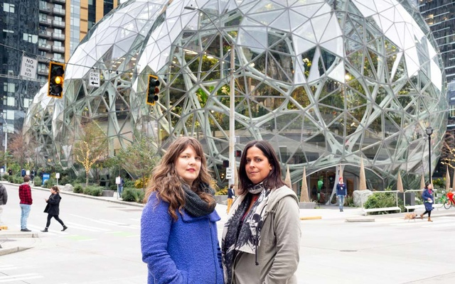 Emily Cunningham, left, and Maren Costa outside Amazon's Seattle headquarters on Dec 3, 2019, had publicly pushed the company to reduce its impact on climate change and address concerns about its warehouse workers. Amazon illegally retaliated against two of its most prominent internal critics when it fired them last year, the National Labour Relations Board has determined. Jenny Riffle/The New York Times