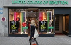 Posters offering special discount on Black Friday sales are seen in front of a United Colours of Benetton kid's fashion store, as the spread of the coronavirus disease (COVID-19) continues, in Zurich, Switzerland November 27, 2020. REUTERS/Arnd Wiegmann