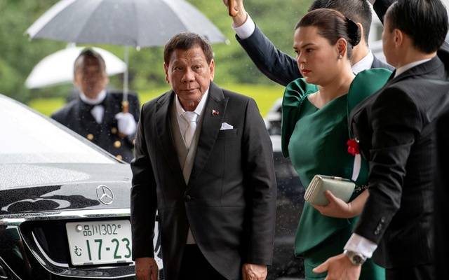 Philippines President Rodrigo Duterte arrives with daughter and first lady Sara Duterte-Carpio to attend the enthronement ceremony of Japan's Emperor Naruhito in Tokyo, Japan October 22, 2019.