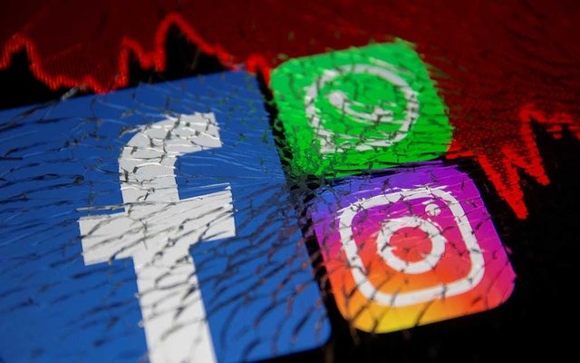 Facebook, Whatsapp and Instagram logos and stock graph are displayed through broken glass in this illustration taken October 4, 2021. REUTERS/Dado Ruvic