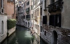 A group takes a gondola ride along a canal in Venice, Italy, Sept 13, 2021. The city's leaders are acquiring the cellphone data of unwitting tourists and using hundreds of surveillance cameras to monitor visitors and prevent crowding. The New York Times