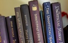 """Various copies of """"The Unofficial Harry Potter Cookbook,"""" by Dinah Bucholz, at Bucholz's home in Philadelphia, Sept 26, 2021. """"The Unofficial Harry Potter Cookbook'' has sold more than one million copies and been translated into several languages. Caroline Gutman/The New York Times"""