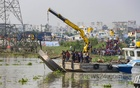 Rescuers pull out a boat at Gabtoli in Dhaka after it capsized in the Turag river near Koylar Ghat in Aminbazar on Saturday, Oct 9, 2021. Photo: Asif Mahmud Ove