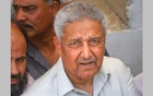 Pakistani nuclear scientist Abdul Qadeer Khan is photographed after a silent prayer over the grave of his brother Abdul Rauf Khan, during funeral services in Karachi May 8, 2011. REUTERS