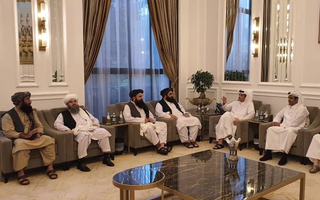 Taliban delegates meet with Qatar delegates in Doha, Qatar, in this handout photo uploaded to social media on October 9, 2021. Reuters