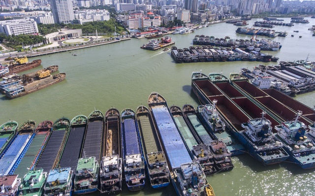 Boats return to port to avoid Typhoon Lionrock, the year's 18th typhoon, in Haikou city, south China's Hainan province, 12 October 2021. REUTERS