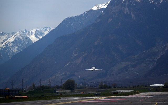 A Bombardier BD-100-1A10 Challenger 350 aircraft (Registration CS-CHE) of NetJets Europe takes off from Sion airport in Sion, Switzerland April 18, 2019. REUTERS