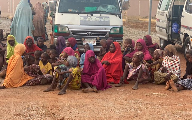 Women and children who were kidnapped in the northwestern state of Zamfara sit after being rescued by the Nigerian security agents in Zamfara, Nigeria Oct 7, 2021. REUTERS