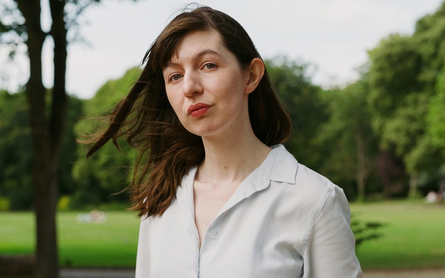 """Sally Rooney in Merrion Square in Dublin on Jul 24, 2021. The author of """"Beautiful World, Where Are You"""" turned down an offer from an Israeli publisher to translate the novel to Hebrew, citing her support for Palestinians """"in their struggle for freedom, justice and equality."""" Ellius Grace/The New York Times"""