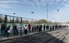 People line up at a COVID-19 testing site setup at a tennis centre in Wavertree, England, Nov 6, 2020. Prime Minister Boris Johnson's slowness last year to impose a lockdown and institute widespread testing had tragic results, according to a parliamentary report. (Mary Turner/The New York Times