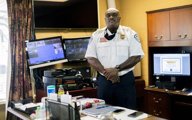 Carl K Dunn, the chief of police, in his office in Baker, La, on Sept 21, 2021. Dunn says he talks to his officers about the benefits of vaccination, citing a colleague's death as a cautionary tale, but does not favor making shots mandatory. Emily Kask/The New York Times