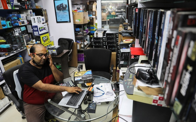 Piyush Tulsian, a retailer who sells products on Amazon.in, speaks on a mobile phone in his shop in New Delhi, September 15, 2021. Picture taken September 15, 2021. REUTERS/Anushree Fadnavis