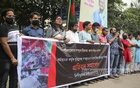 A group of people demonstrate at Shahbagh in Dhaka on Thursday, Oct 14, 2021 in protest against attacks on Hindu temples and Durga Puja pavilions in parts of Bangladesh on allegations that the Quran was dishonoured at a puja venue in Cumilla.