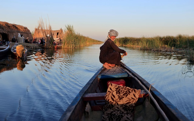 A man paddles his boat at the Chebayesh marsh, Dhi Qar province, Iraq, August 13, 2021. REUTERS