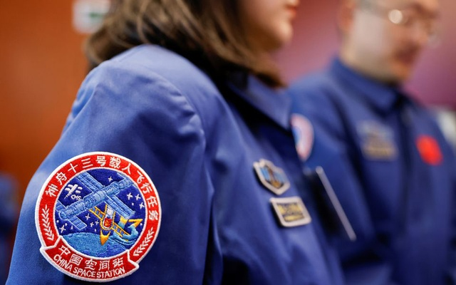 A patch of the Shenzhou-13 is seen in the uniform of a staff member, during a news conference ahead of the launch of the Long March-2F Y13 rocket, carrying the Shenzhou-13 spacecraft and three astronauts in China's second crewed mission to build its own space station, at Jiuquan Satellite Launch Center near Jiuquan, Gansu province, China, October 14, 2021. REUTERS/Carlos Garcia Rawlins
