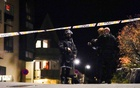 Police officers investigate after several people were killed and others were injured by a man using a bow and arrows to carry out attacks, in Kongsberg, Norway, Oct 13, 2021. Hakon Mosvold/NTB/via REUTERS