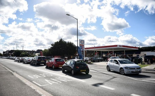 A line for gas in Slough, west of London, on Wednesday, Sept. 29, 2021. Long lines at gas stations in Britain last month were caused not by a shortage of fuel, but a shortage of truck drivers to deliver the fuel. (Mary Turner/The New York Times)