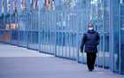 A woman wearing a protective face mask walks along a deserted city bridge during morning commute hours on the first day of a lockdown as the state of Victoria looks to curb the spread of a coronavirus disease (COVID-19) outbreak in Melbourne, Australia, July 16, 2021. REUTERS