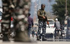 Indian Central Reserve Police Force (CRPF) personnel stand guard on a street in Srinagar, October 12, 2021. REUTERS/Danish Ismail