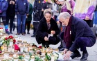 Norway's Prime Minister Jonas Gahr Stoere (Labor Party) lays flowers and lights candles during his visit to Kongsberg after a deadly attack, Norway, Oct 15 2021.Terje Bendiksby/ REUTERS