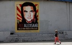 A woman walks by a mural in support of the liberation of Colombian businessman and envoy Alex Saab, who is detained in Cape Verde on charges of laundering money for the government of Venezuelan President Nicolas Maduro, in Caracas, Venezuela September 9, 2021. REUTERS