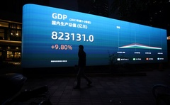 An electronic display showing the China GDP indexes is seen on a street in Shanghai, China October 18, 2021. Reuters