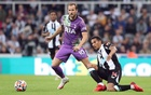 Football - Premier League - Newcastle United v Tottenham Hotspur - St James' Park, Newcastle, Britain - October 17, 2021 Tottenham Hotspur's Harry Kane in action with Newcastle United's Isaac Hayden REUTERS
