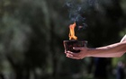 A cauldron and flame is held by a performer during the Olympic flame lighting ceremony for the Beijing 2022 Winter Olympics REUTERS. Winter Olympics - Lighting ceremony of the Olympic flame for the Beijing 2022 Winter Olympics - Ancient Olympia, Olympia, Greece - October 18, 2021