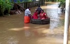 Bride and groom float to a temple in a cooking vessel on a flooded road for their wedding ceremony in this screengrab taken from video, in Alappuzha, Kerala, India, October 18, 2021. REUTERS TV