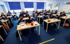 Students attend a lesson at Weaverham High School, as the COVID-19 lockdown begins to ease, in Cheshire, England, March 9, 2021. REUTERS