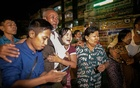 People react outside Insein prison as Myanmar's Junta releases prisoners including people that protested against the military coup, in Yangon, Myanmar Oct 18, 2021. REUTERS