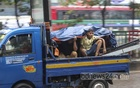 Passengers on a pickup truck used plastic covers to protect themselves from the rain on Tuesday, Oct 19, 2021. Photo: Asif Mahmud Ove