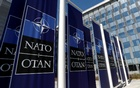 Banners displaying the NATO logo are placed at the entrance of NATO headquarters during the move there, in Brussels, Belgium Apr 19, 2018. REUTERS/Yves Herman
