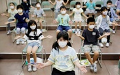 Students wearing protective face masks clap along instead of singing during a music class at Takanedai Daisan elementary school in Funabashi, east of Tokyo, July 16. REUTERS/Kim Kyung-Hoon